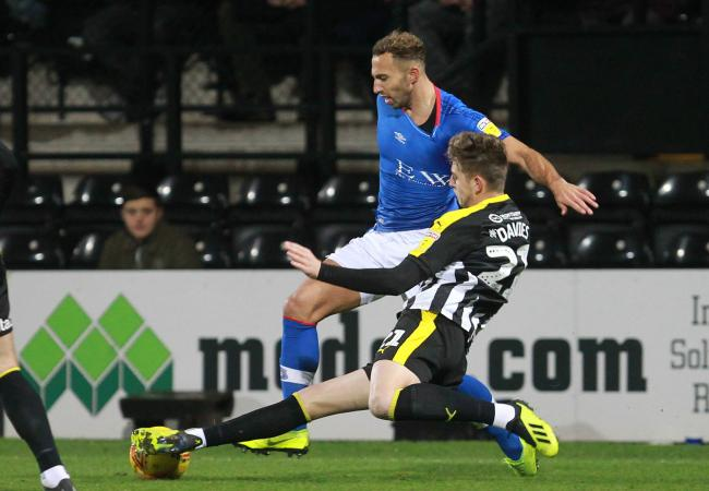 TNS new signing Keston Davies makes a tackle for Notts County. Picture by Richard Parkes