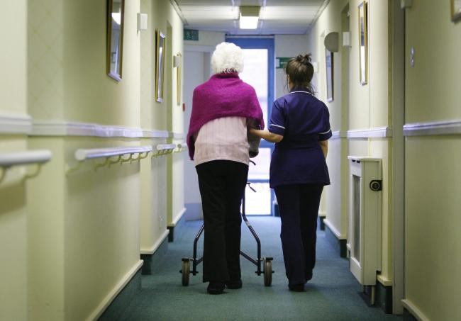 Generic image of old person with a nurse in a care home. Pic: PA