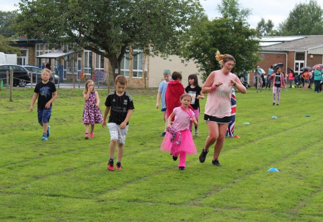 Pupils and staff at Ellesmere Primary School doing their Race for Life