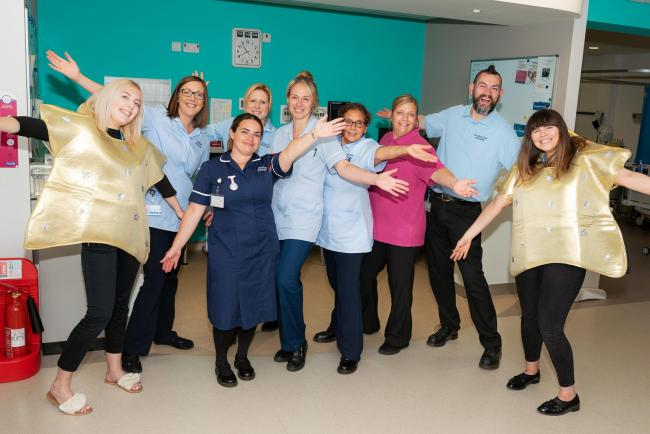Chloe Ellis, Communications Assistant; Staff Nurses Liz Benson; Claire Ford; Louise Naylor; Ann Parrish; Novac Jones, Clinical Support Worker; Lee Mullock, Porter; and Naomi Penrose, Communications Officer, front, Lisa Shaw, Sister on Baschurch Day Unit.