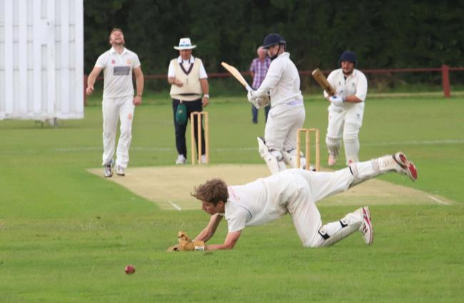 Chirk bowler Andrew Swarbrick looks on as a catch is missed. Picture by Ian Stading