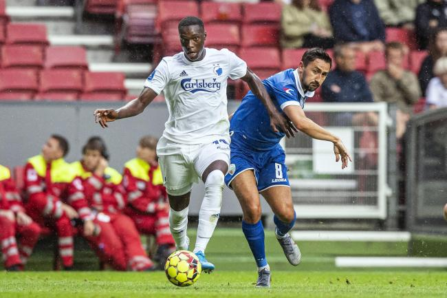 New Saints' Ryan Brobbell, right, battles for the ball with Copenhagen's Mohamed Daramy during Champions League qualifying second round, second leg soccer match between FC Copenhagen and The New Saints FC at Parken Stadium in Copenhagen, Denmark,