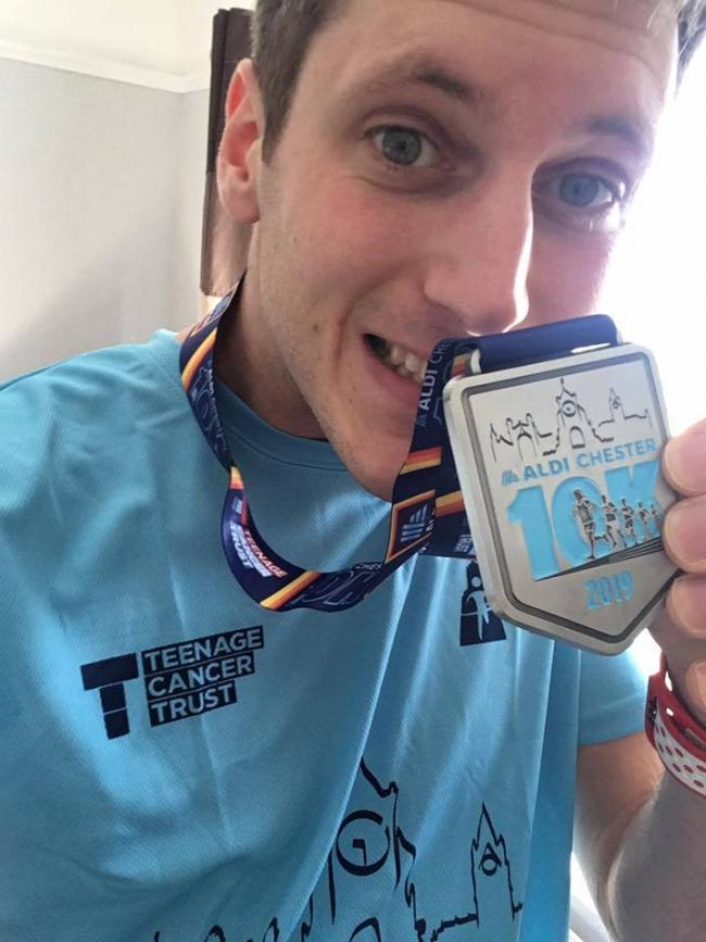James with his celebratory medal after completing a previous challenge