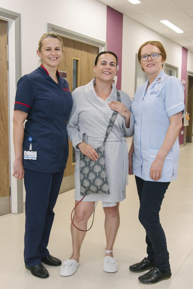 Donna St John, Oswald ward manager and Pip Page-Davies, staff nurse, with Hazel Carter, Oswald Ward patient who uses one of Pip's drain covers