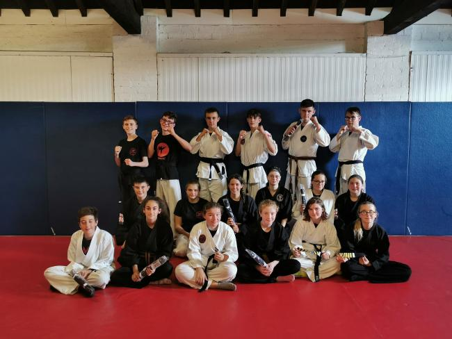 The students who achieved their black belts