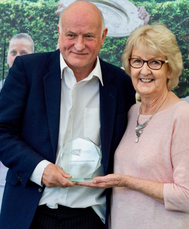 Clive Knight received his LTA Meritorious Service Award from Cathie Sabin, Shropshire's former LTA president