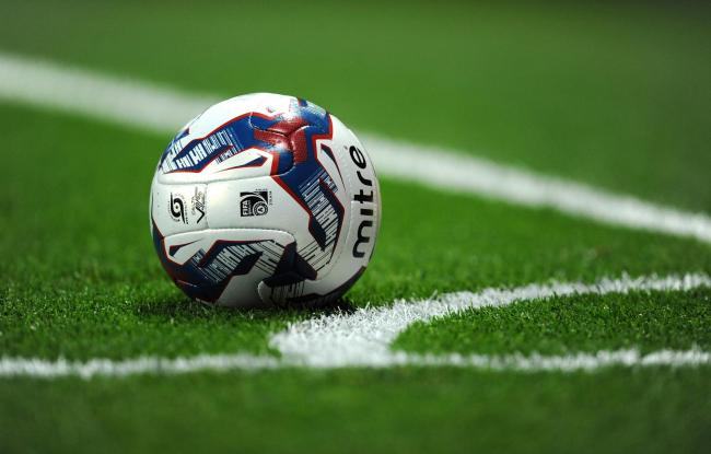A Mitre Football lies outside of the painted line marking the corner during the Capital One Cup Third Round match at the Emirates Stadium, London. PRESS ASSOCIATION Photo. Picture date: Tuesday September 23, 2014. See PA Story SOCCER Arsenal. Photo credit