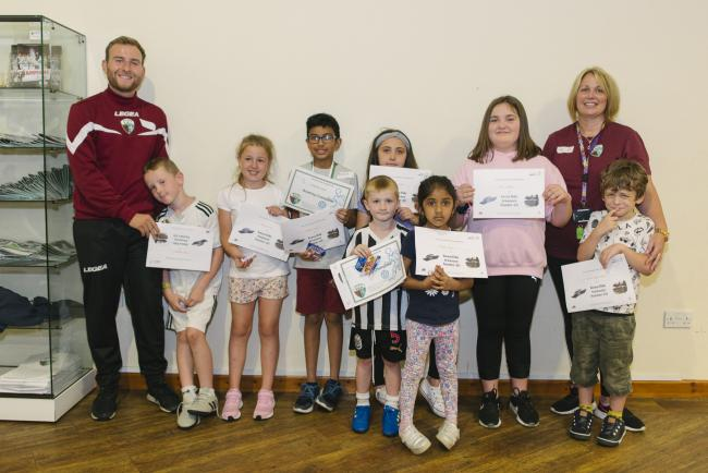 Matt Lee and Shelly McGlinchey from The Venue and The New Saints FC Foundation with children who attended the holiday club.