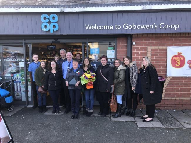 Sue Powell with friends and colleagues at Gobowen's Co-op store in