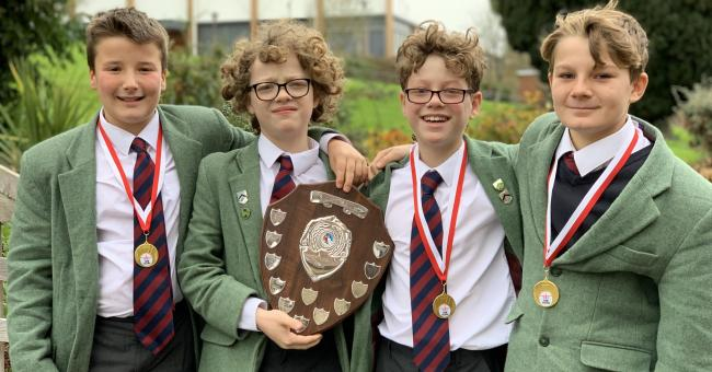 U12 team Rory Ford, Toby Woodman, Elliot Woodman and Arthur Bearman proudly hold their trophy