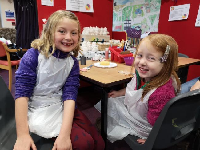 Florence Wilkinson, 6, and Ina Wilkinson, 3, enjoying the pottery painting