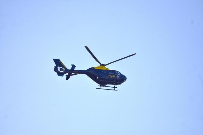 The police helicopter over Oswestry on Wednesday afternoon. Picture by Reuben Hibbert