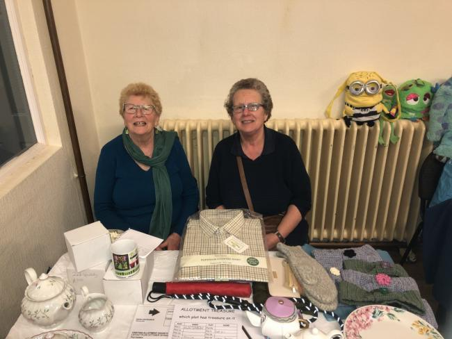 Sharon Kelly, a committee member for the allotments, and Lynn Bailey at the table top sale