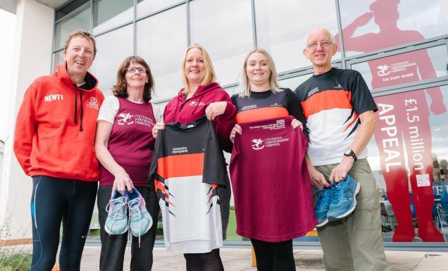 Members of The Marches School Oswestry 10k organising committee, Dave Newton, Ellen Harrison, Ashling Donohue-Harrison and Ray Pickett with Helen Knight