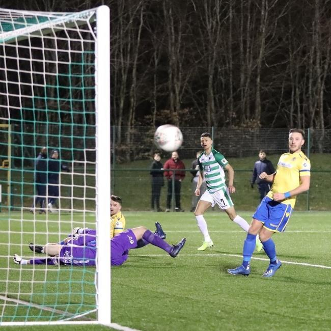 Dean Ebbe strikes at goal against Barry Town United. Picture by Brian Jones