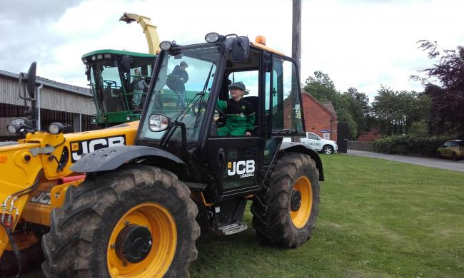 A visitor enjoying the farm machinery display at a previous Open Farm Sunday event in 2017