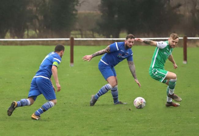 Chirk Town FC (blue) in action earlier this season. Picture by Ian Stading