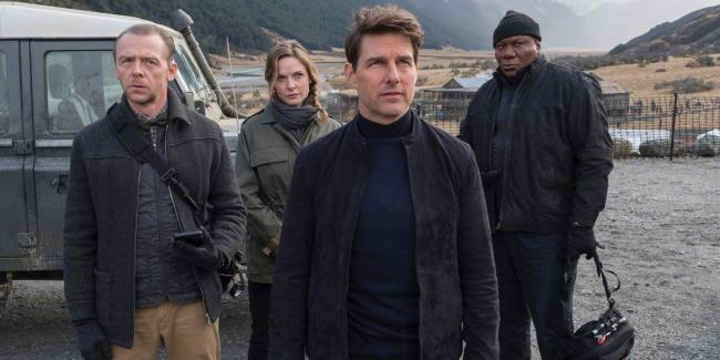 Tom Cruise with Simon Pegg, Rebecca Ferguson and Ving Rhames.