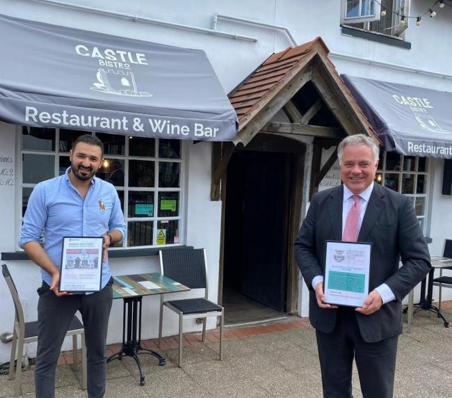 Reza Noori and Simon Baynes MP outside Castle Bistro in Chirk