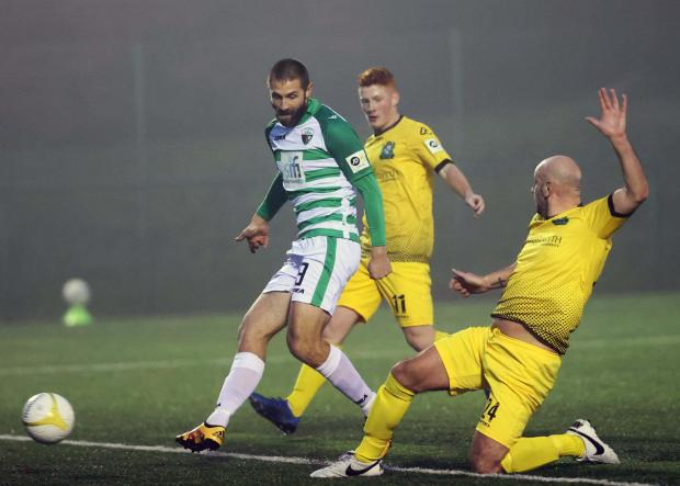 Border Counties Advertizer: Greg Draper in action against Aberystwyth Town. Picture by Brian Jones