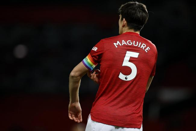 Manchester United captain Harry Maguire adjusts his armband