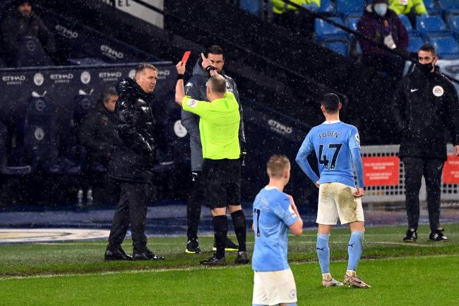 Aston Villa manager Dean Smith was sent off by referee Jon Moss at Manchester City on Wednesday