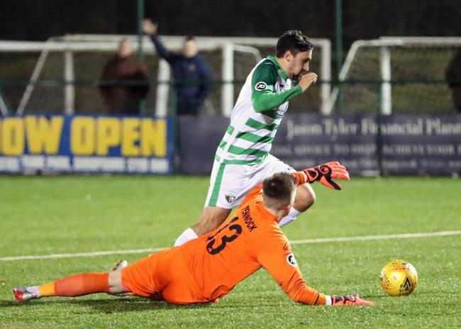 Ryan Brobbel rounds the keeper to net the second for TNS. Picture by Brian Jones
