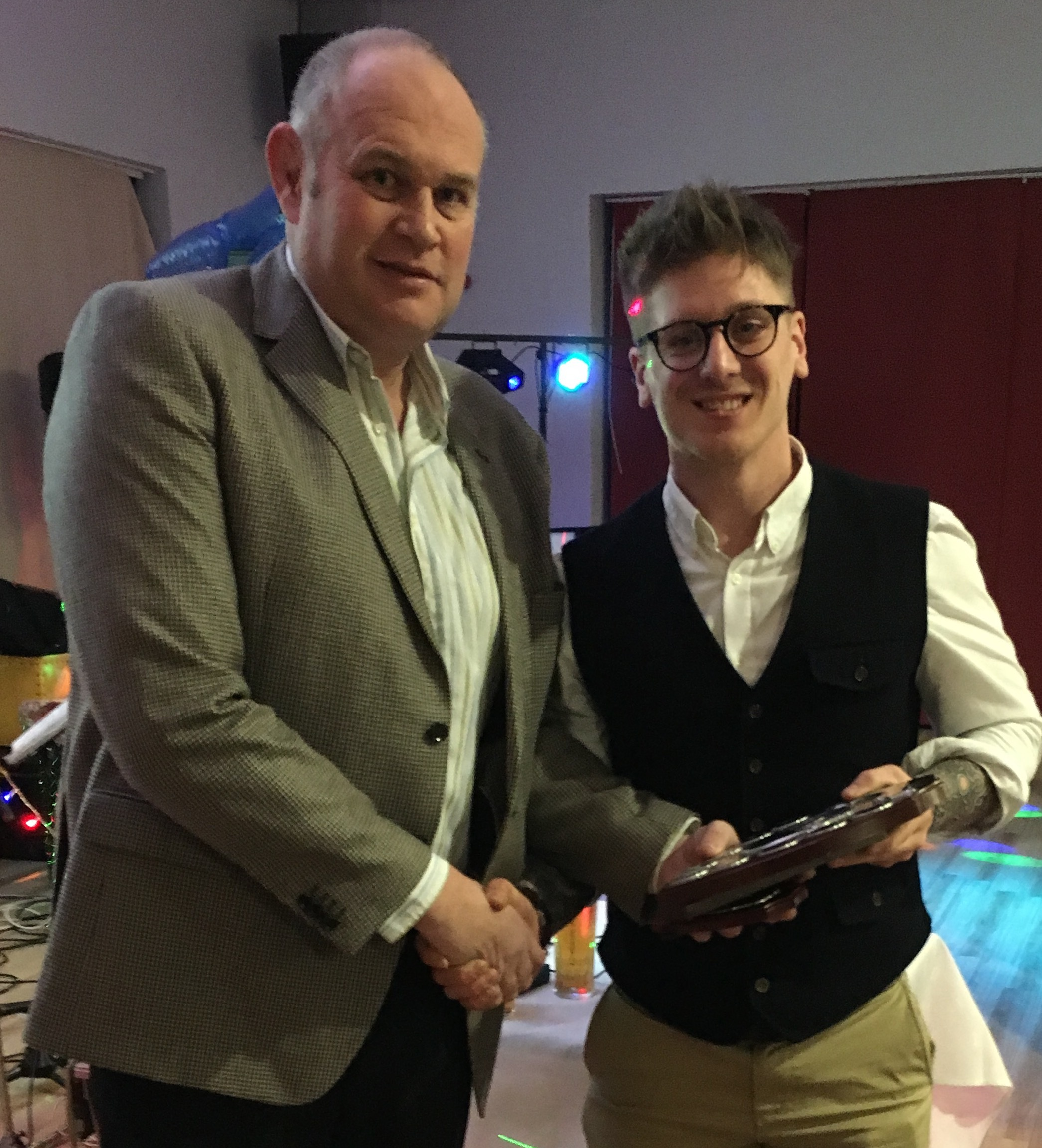 Steven Owen presents Apprentice of the Year Sam Wycherley with his plaque at the company awards