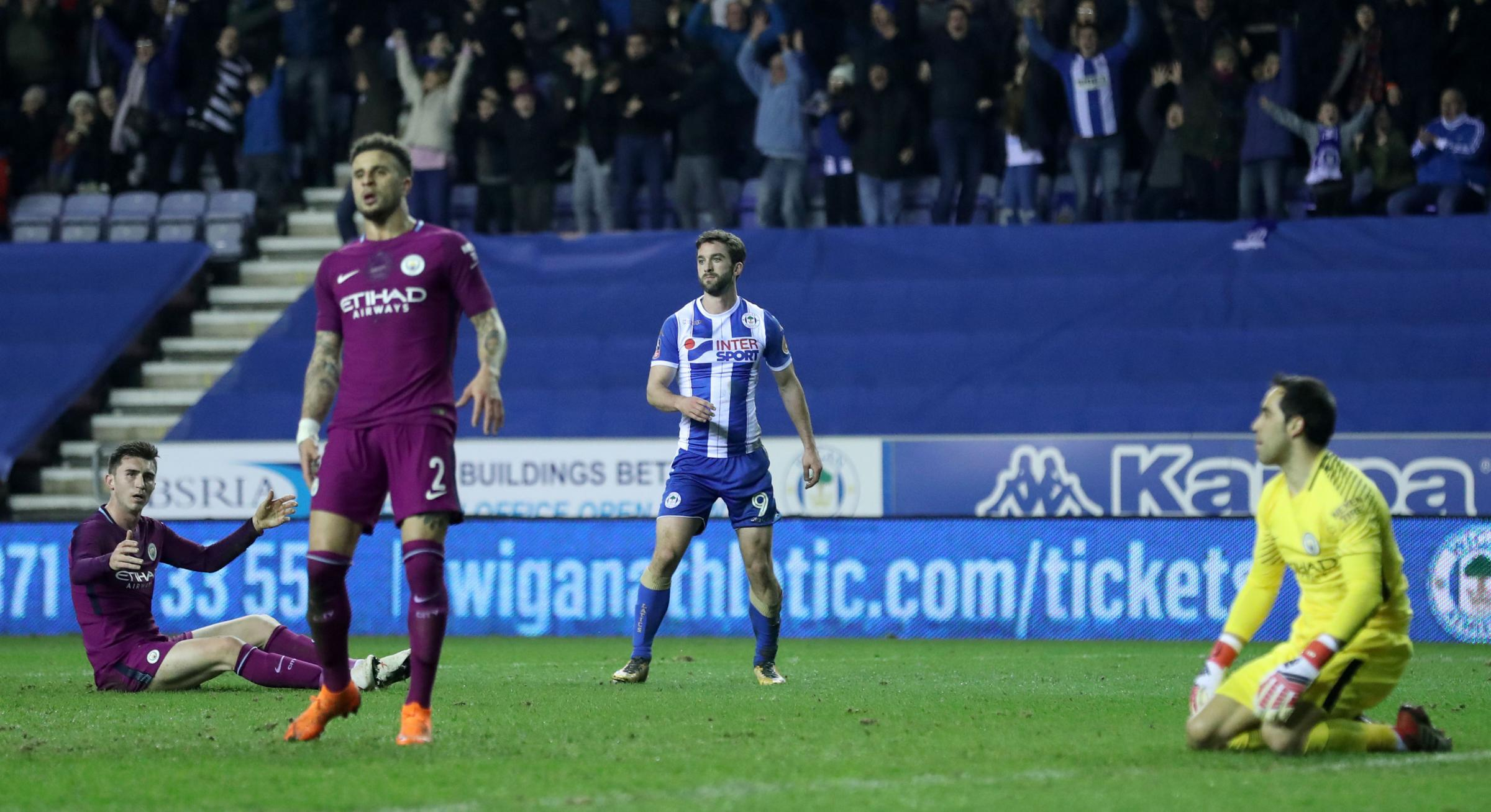 Wigan Athletic's Will Grigg (centre right) reacts after scoring his side's first goal of the game during the Emirates FA Cup, Fifth Round match at the DW Stadium, Wigan. PRESS ASSOCIATION Photo. Picture date: Monday February 19, 2018. See PA story