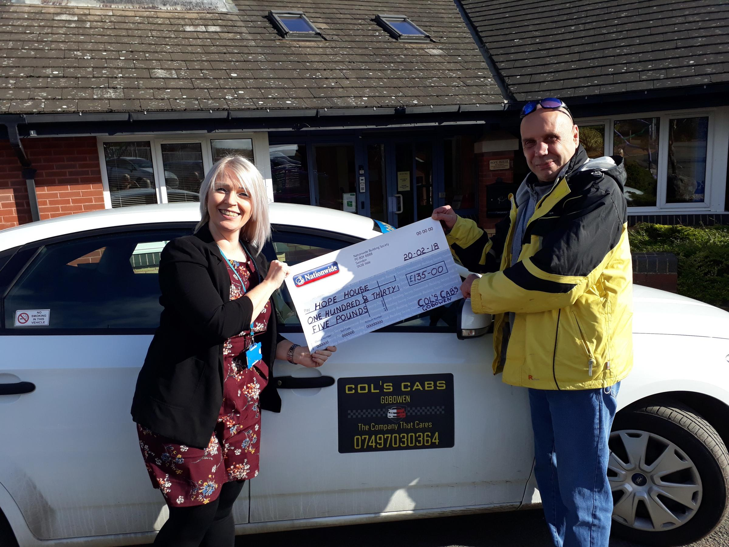 Colin Davies, of Col's Cabs, presents the cheque to Lynsey Kilvert, of Hope House