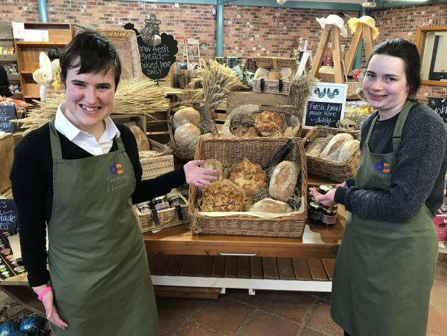Derwen College students Brittany Jones and Alice Hirst with a selection of the breads on sale