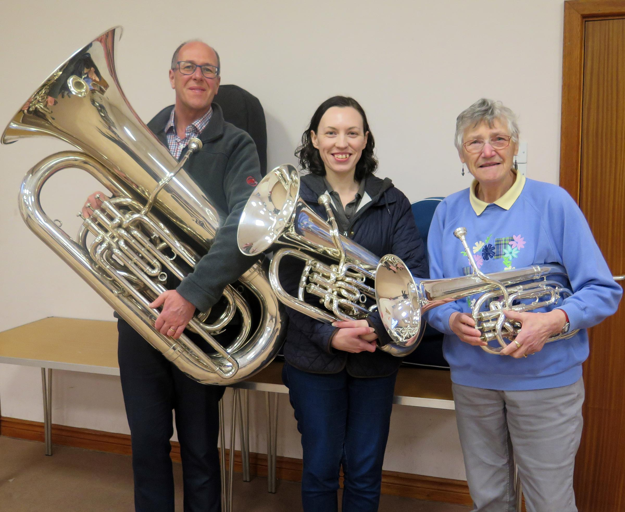 Members of the Porthywaen Silver Band with their instruments. Dirk Commerford (Bb Bass Tuba), Bethan Jones (Euphonium) and Barbara Bridgwater (Baritone Horn)