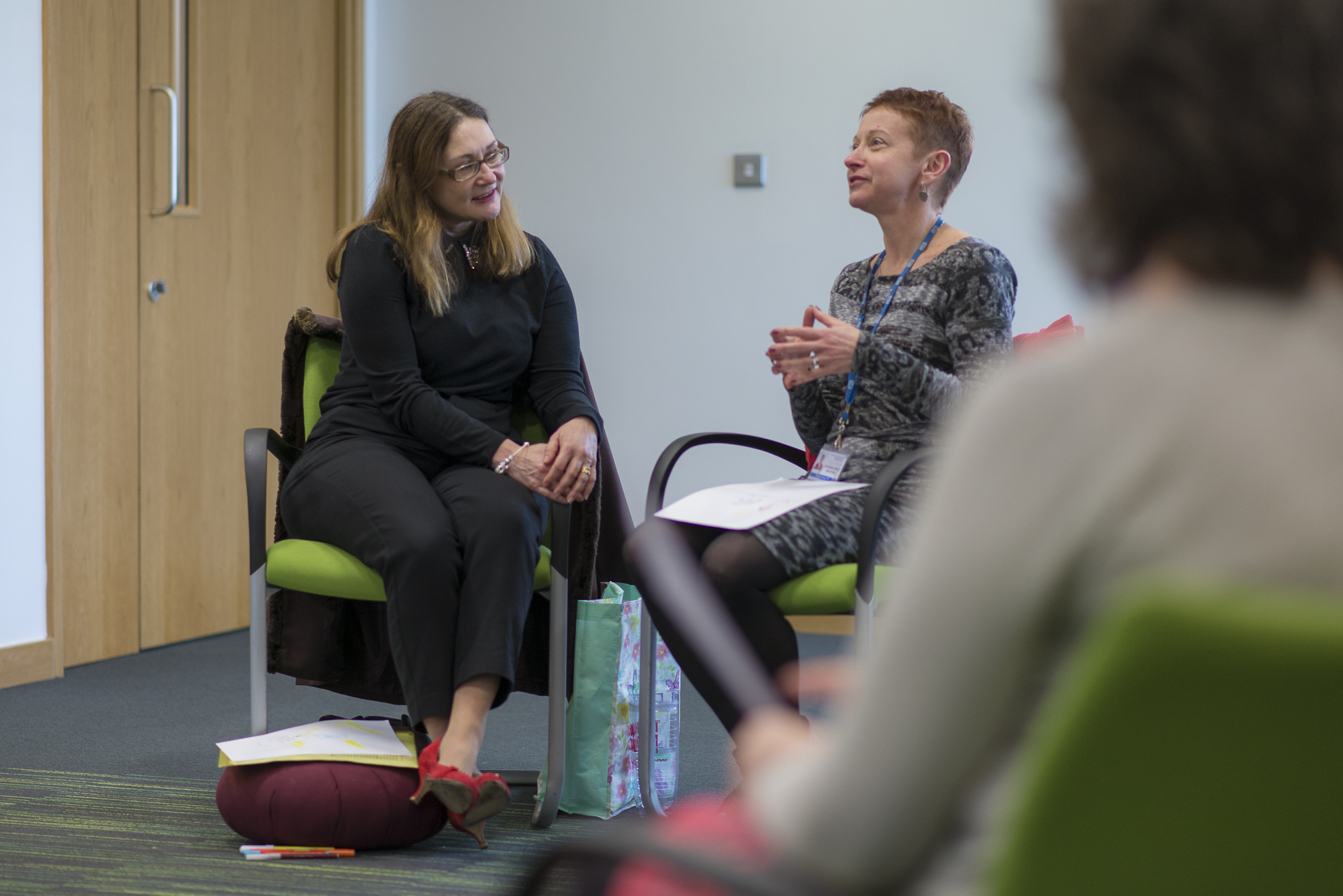 Two members of RJAH staff during one of the Mindfulness sessions discussing 'interacting with others'