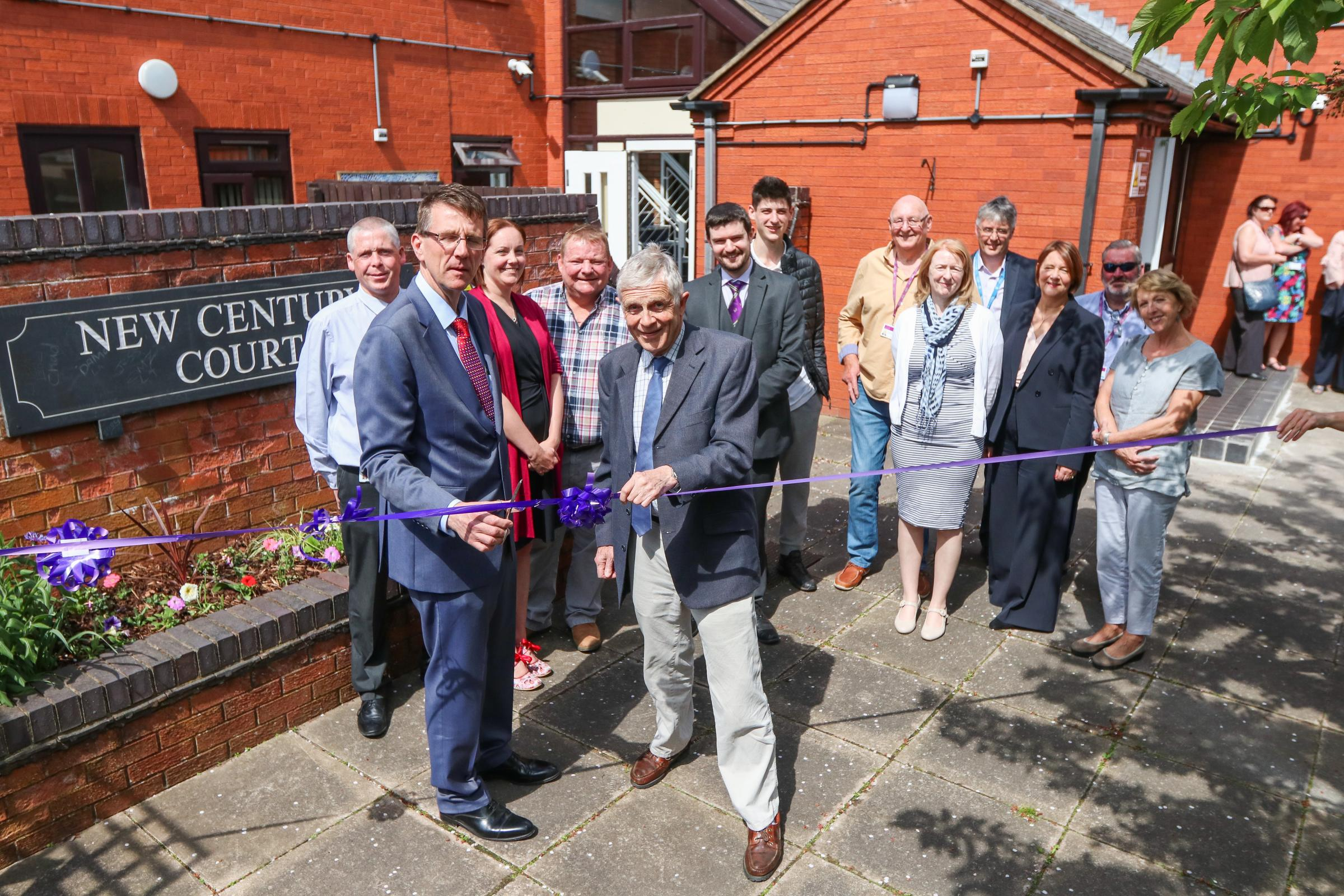 Lee Chapman ( cabinet member for housing), Nick Bardsley (cabinet member for childrens services cut the ribbon...Official opening of New Century Court, Oswestry..New Century Court provides accommodation with support for young people aged 16-25. The proper