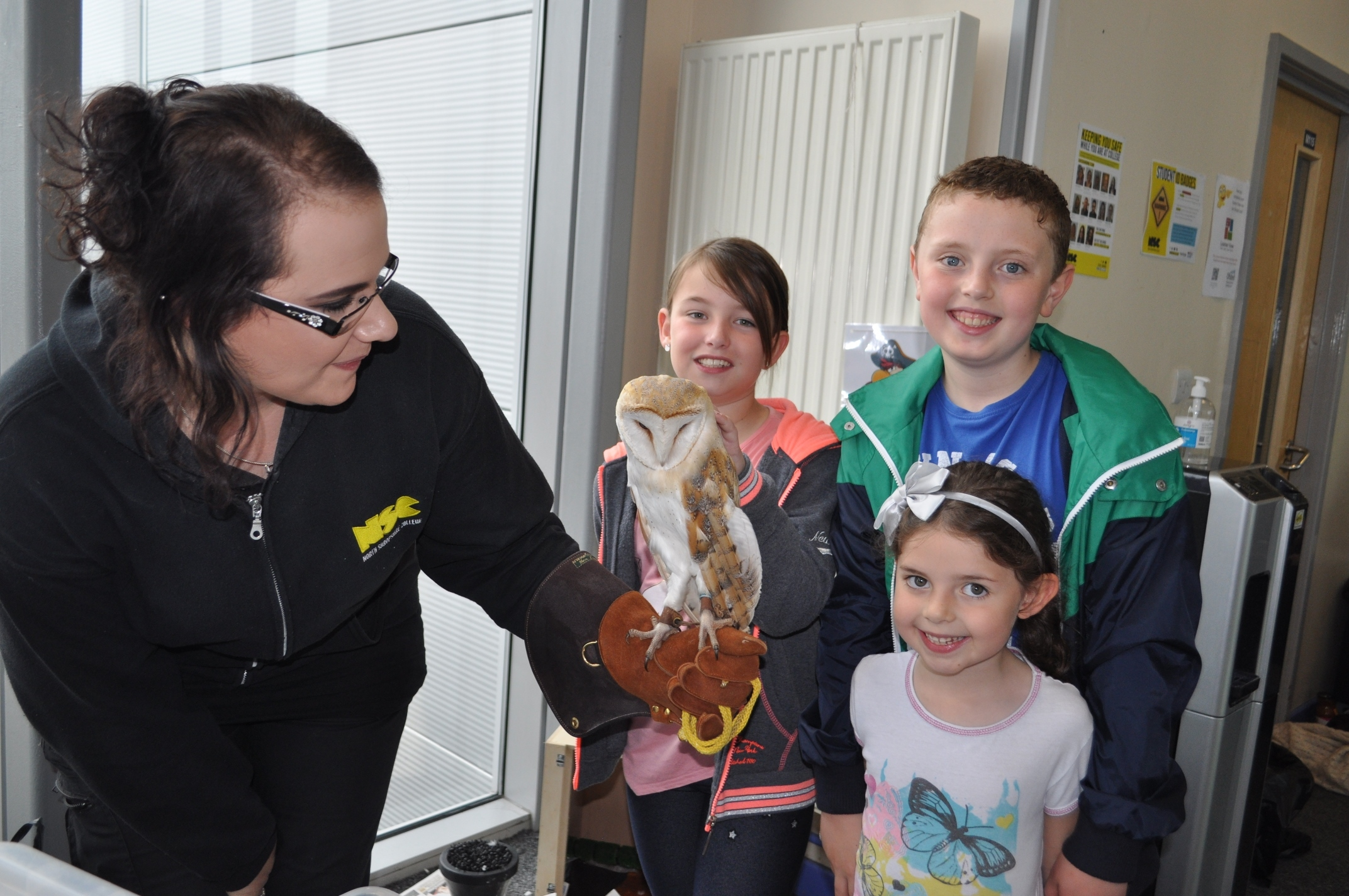Bex Walker NSC Tutor with Luna the Owl and Children L-R Leila Shearer, Luca Edwards & Gabriella Edwards at last year's Family Fun Day