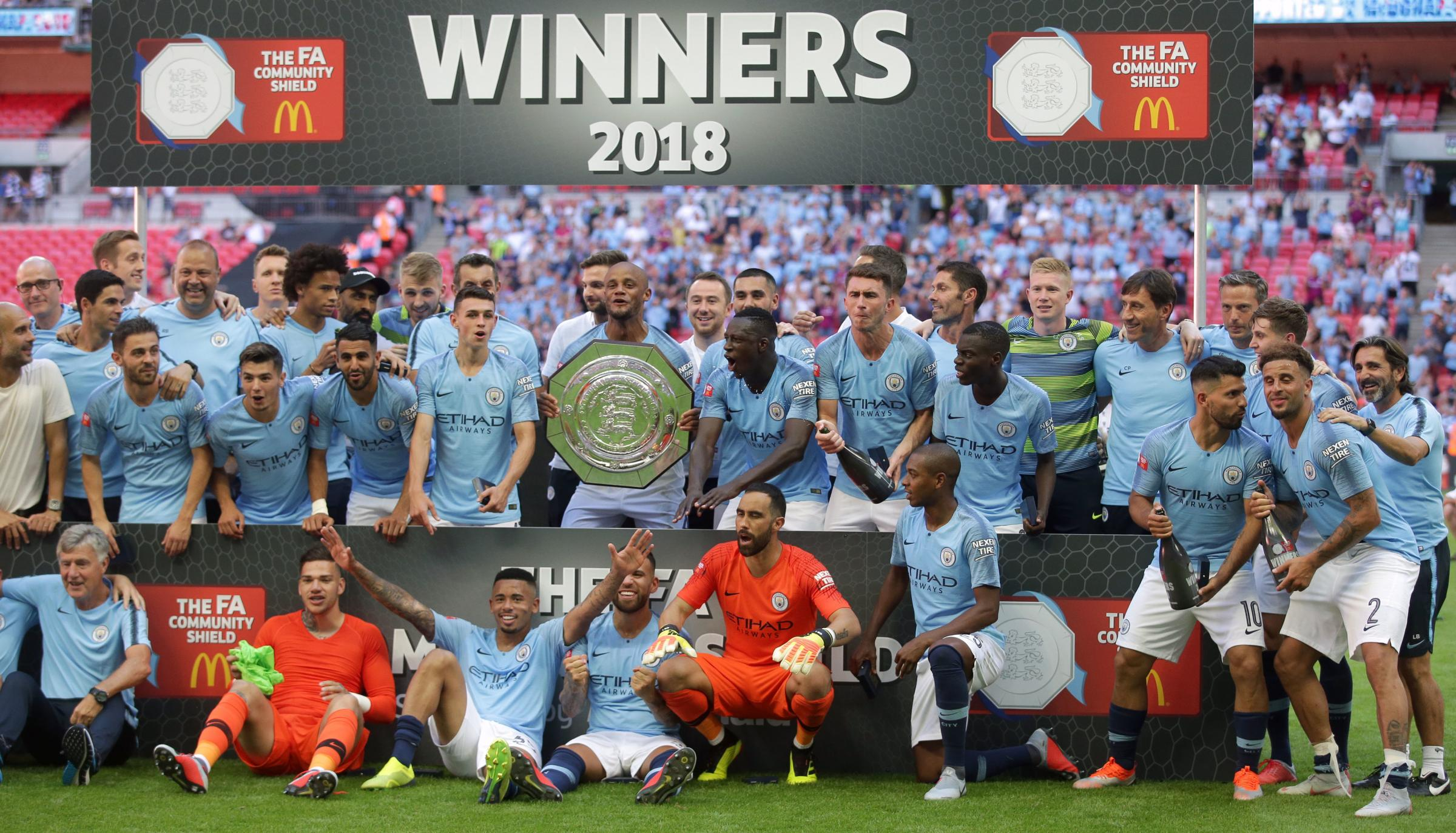 Manchester City players celebrate with the Community Shield after winning the Community Shield match at Wembley Stadium, London. PRESS ASSOCIATION Photo. Picture date: Sunday August 5, 2018. See PA story SOCCER Community Shield. Photo credit should read: