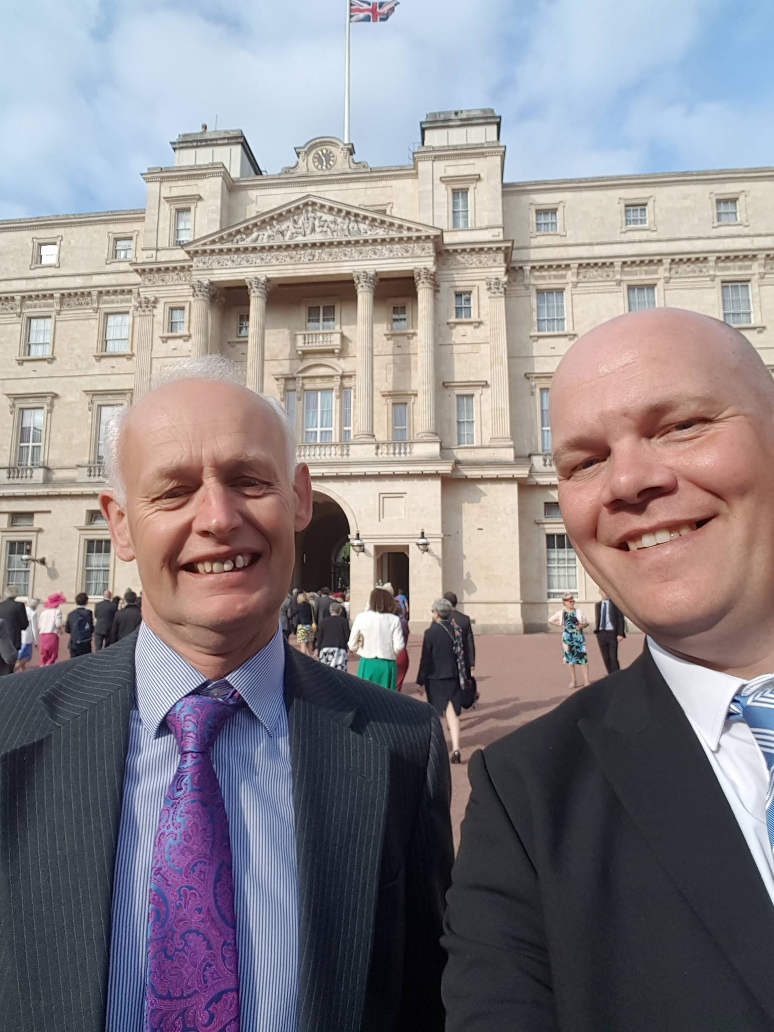 Knocking and Kinnerley CC vice chairman, Ed Nicholas, and juniors co-ordinator Gary Darlington outside Buckingham Palace