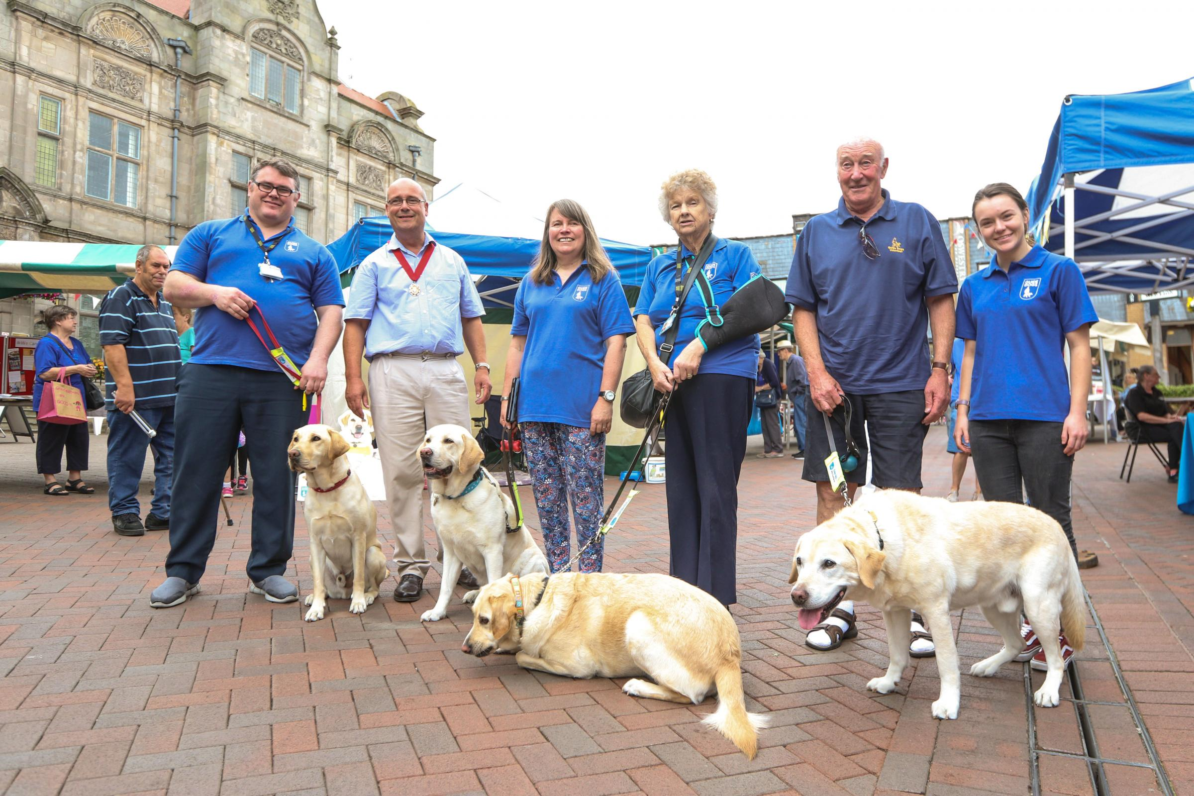 Guide dog event in Oswestry.Andy Farrell, Deputy Mayor John Price, Lin Stapley, Sue Roberts, Ian Murray and Sara Edwards. Dogs are Declan,Woody,Vicky and Delphie..cc030818A.