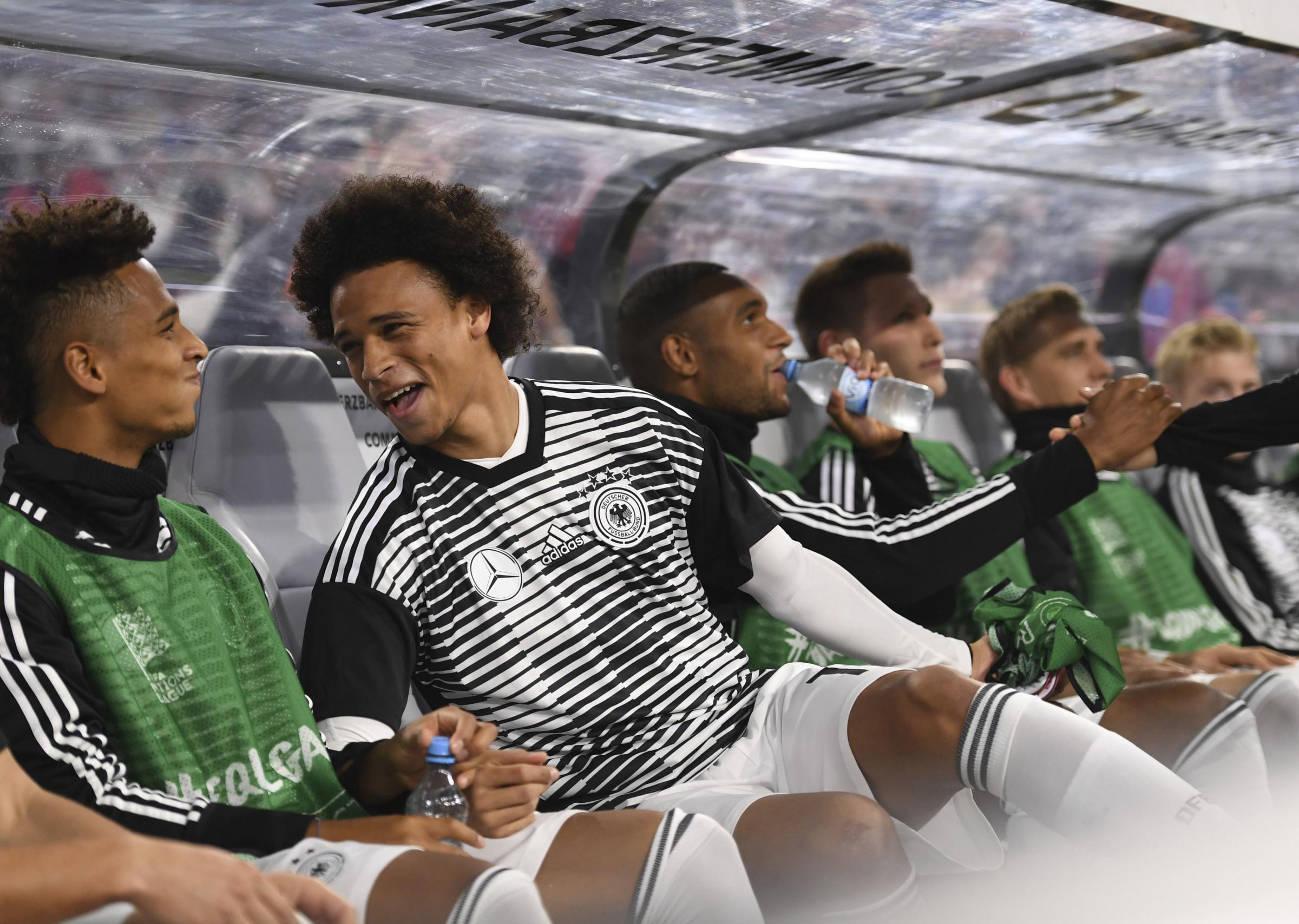 Germany's Thilo Kehrer, left, and Leroy Sane, second left, sit on the bench during the UEFA Nations League soccer match between Germany and France in Munich, Germany, Thursday, Sept. 6, 2018. (Marius Becker/dpa via AP).