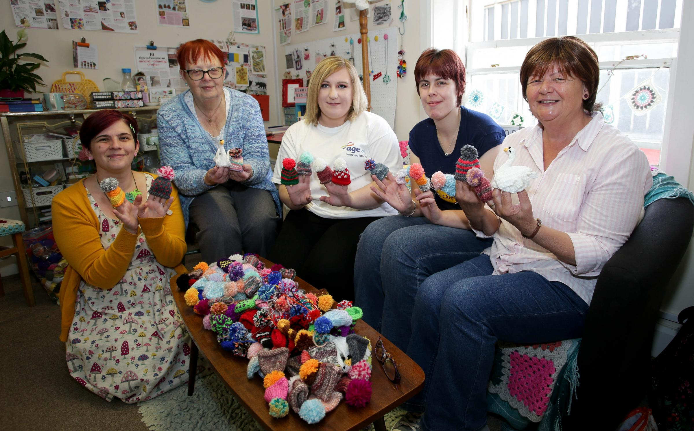 RM300818c.Gemmipops Designs, Willow Street Oswestry.A Big Knit along for Age UK -  knitting mini bobble hats to go on top of Innocent Smoothie Bottles..Gemma Bentley, Lilian Ashley, Angela Goodman (Age UK), Megan Richardson and Libby Manning.