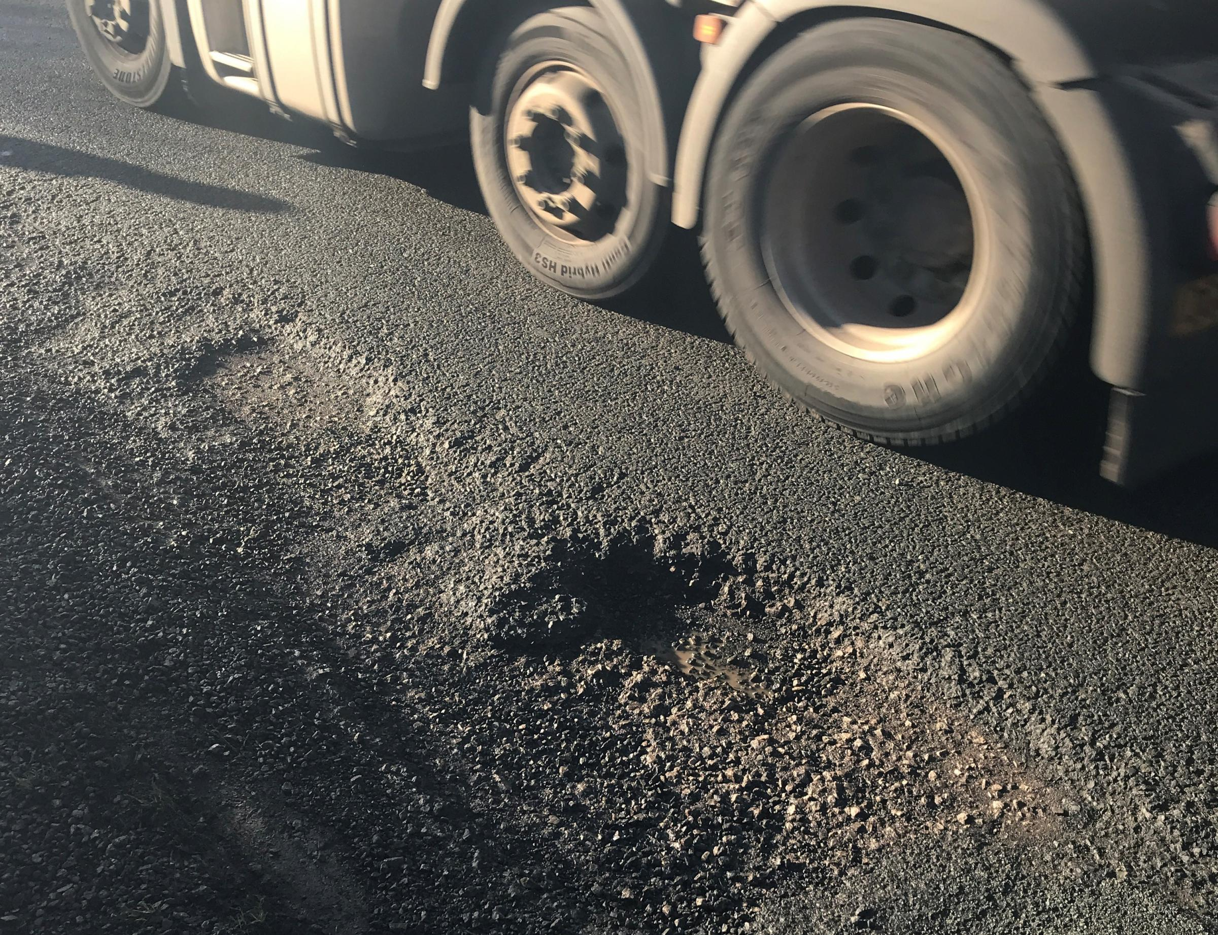 An image of a lorry passing a large pothole on the A525 near Bronington, which was taken by Antony Maybury from Wrexham