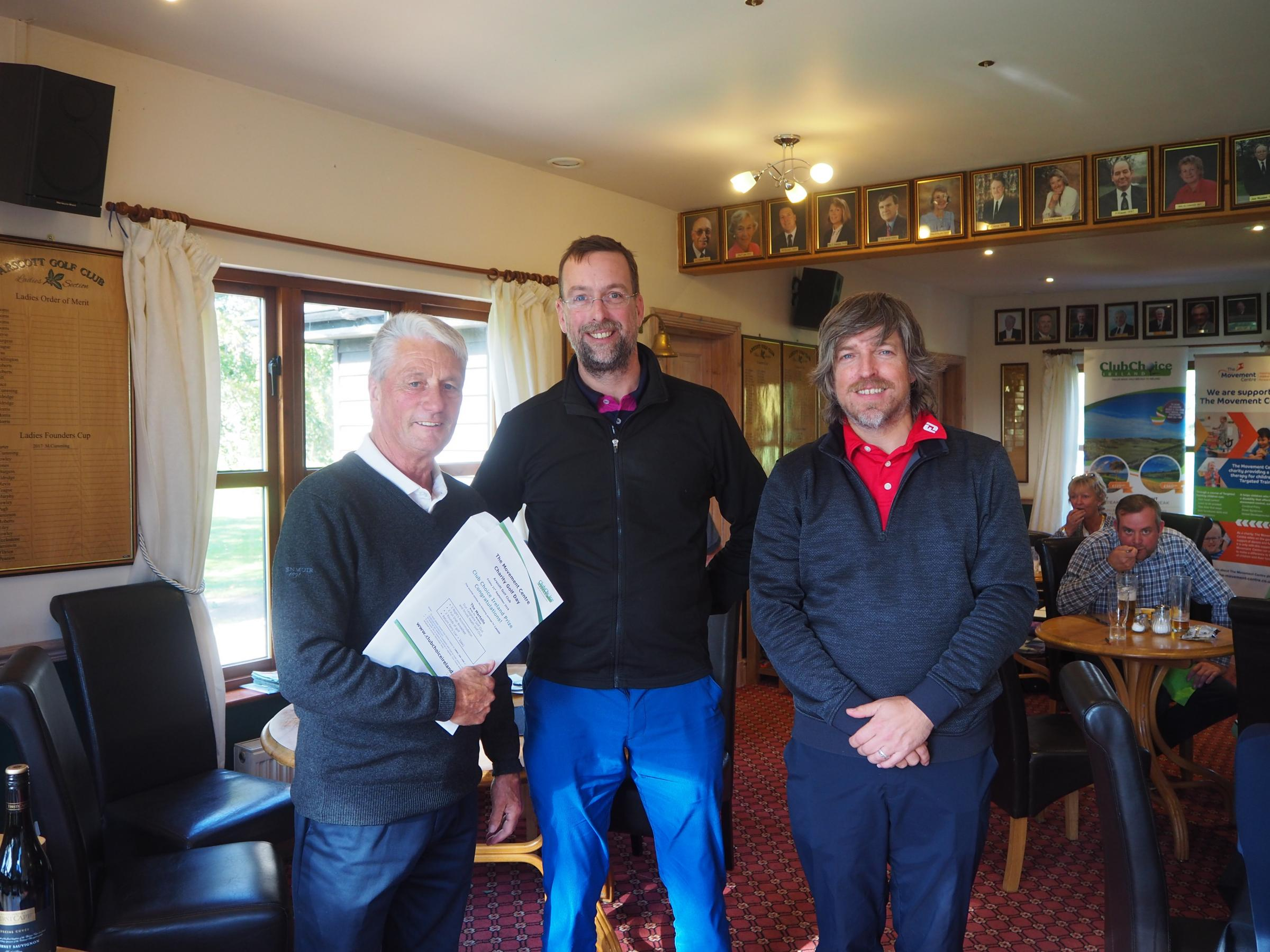 Larry Byrne, Club Choice Ireland, with winners Jonathan Pierce and Robert Williams from Harrisons Solicitors.