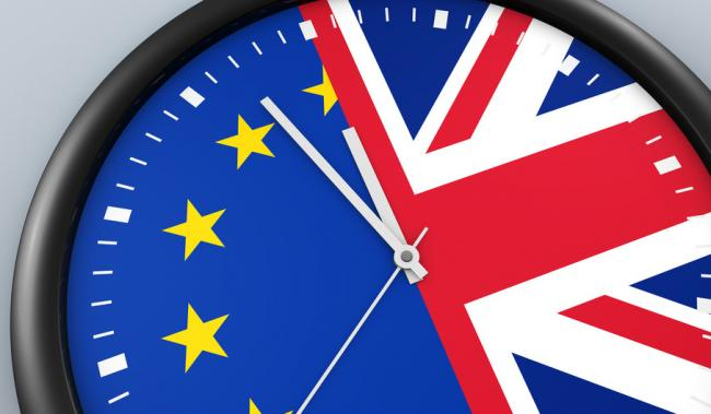 Brexit UK exit from EU negotiation process concept with Union Jack and European Union flag on a clock 3D illustration..