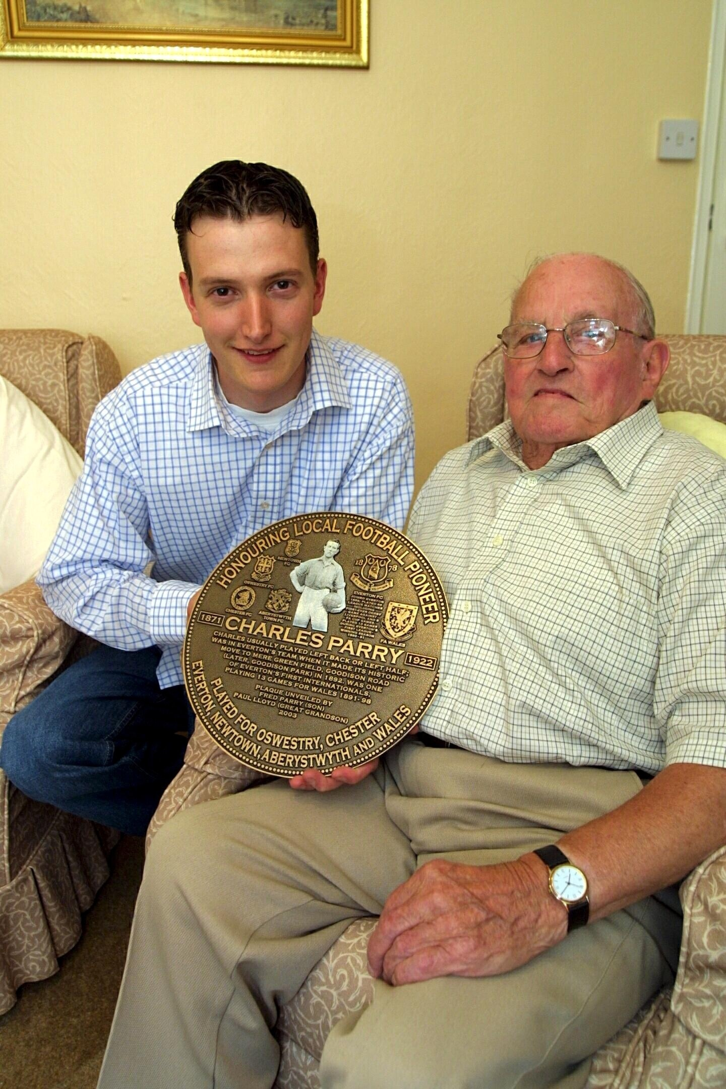 The plaque dedicated to Oswestry football pioneer, Charles Parry held by his great grandson, Paul lloyd, and his son, Fred Parry. The plaque will be mounted in the Powys Hall on August 27th at 12 - 00. The family wish to thank all the contributors who mad