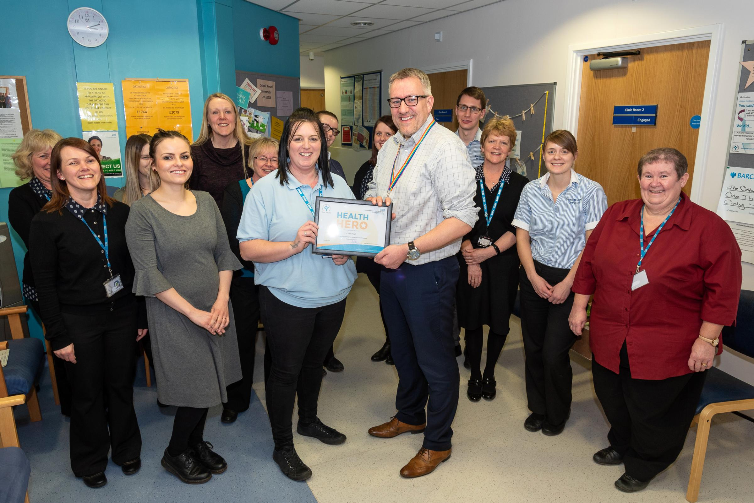 Chief executive Mark Brandreth presenting orthotic assistant Clare Pugh with her Health Hero Award alongside her colleagues in Orthotics.