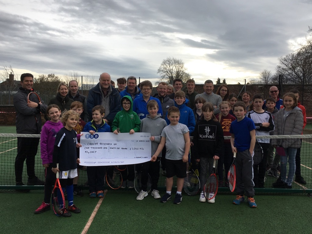 Members of the Oswestry Team Tennis club present the cheque
