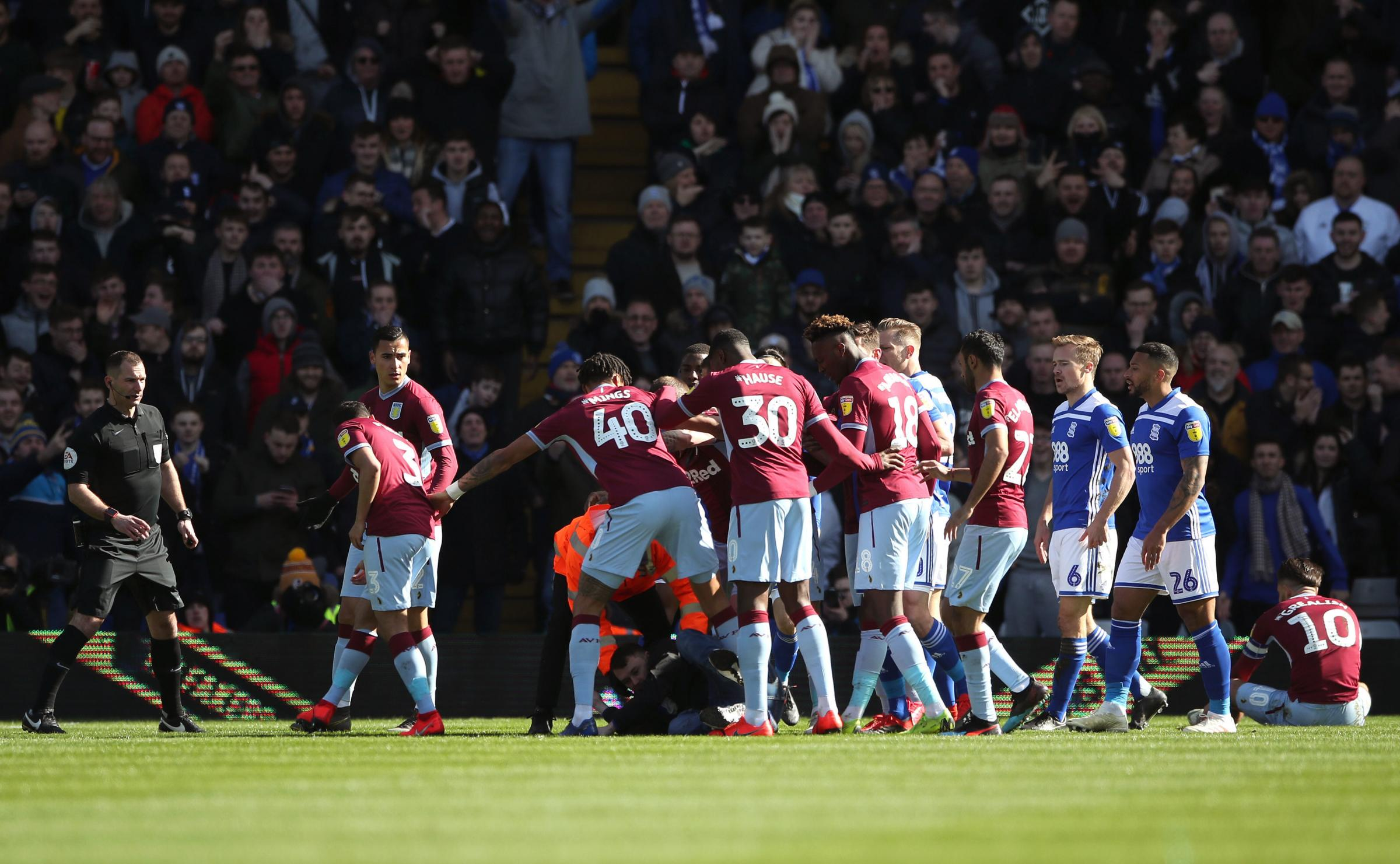 A fan attacks Aston Villa's Jack Grealish on the pitch (right) during the Sky Bet Championship match at St Andrew's Trillion Trophy Stadium, Birmingham. PRESS ASSOCIATION Photo. Picture date: Sunday March 10, 2019. See PA story SOCCER Birmingham.