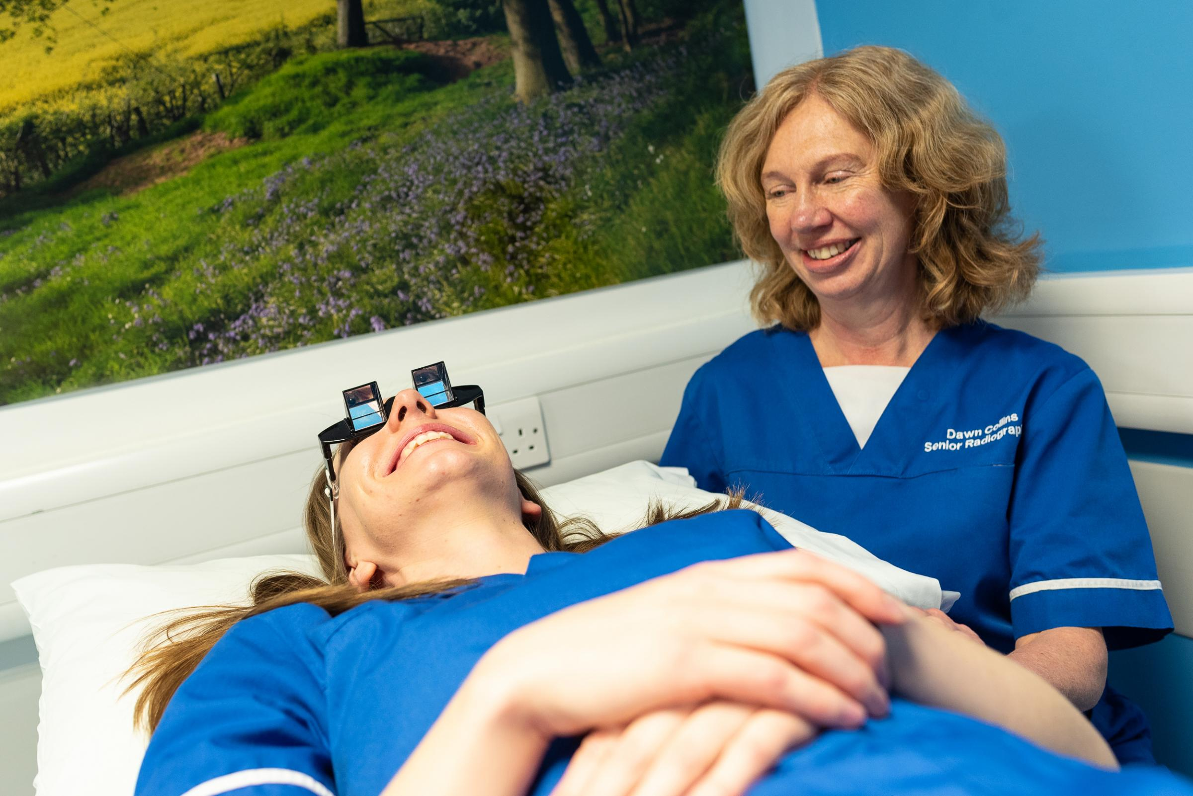 Senior radiographer Jodie Rogers wearing the prism glasses with lead MRI radiographer Dawn Collins.