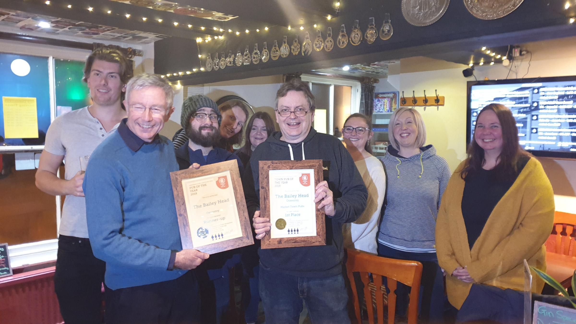Duncan Borrowman (right) being presented with Shrewsbury and West Shropshire CAMRA Market Towns Pub of the Year Winner and overall Pub of the Year runner up certificates by Dave Roll, Chair of Shrewsbury and West Shropshire CAMRA