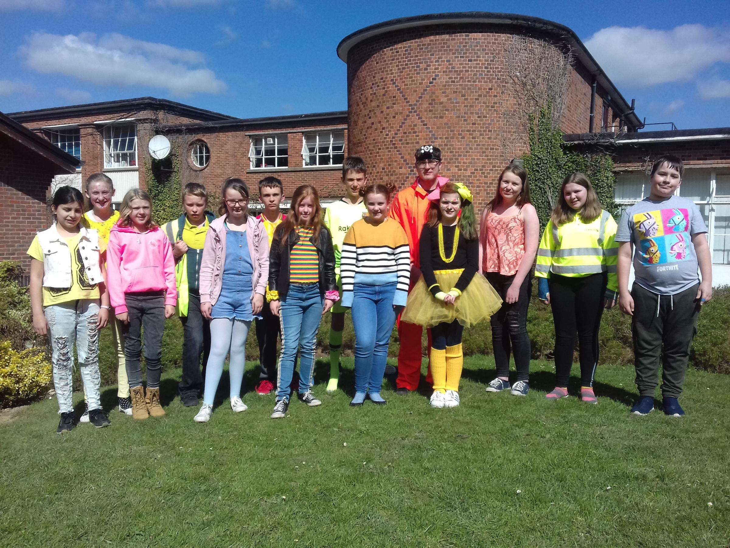 Students at Llanfyllin High School dressed in bright clothing to highlight the issue of climate change